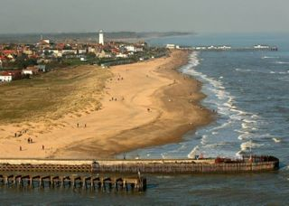 Southwold harbour - aerial shot. Repair works now underway on the harbour wall. Photo source: AngliaAfloat.co.uk