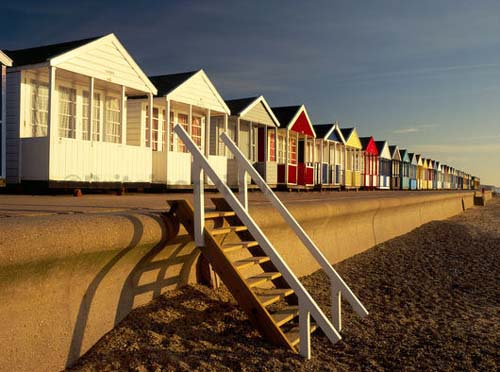 The Olympic Torch will pass the beach huts on its route through Southwold. Photo source: theodora.com