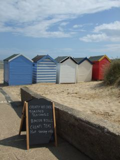 Beach huts in front of Gun Hill's Cafe