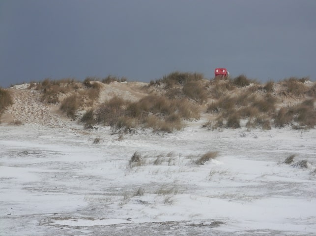 Snow on the dunes of Southwold beach, in March