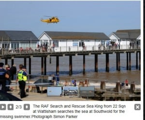 Rescue Sea King helicopter over Southwold Pier saving swimmers