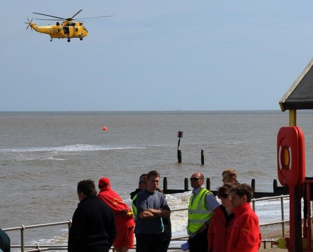 Rescue Sea King helicopter with Southwold lifeguards searching for swimmers