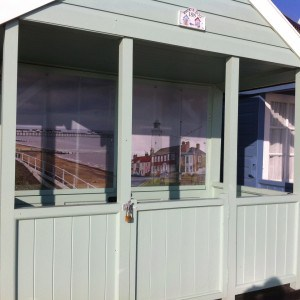 Town pics on beach hut front